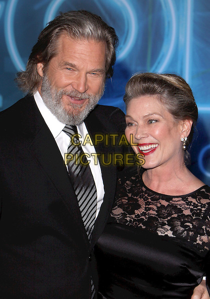 "JEFF & SUSAN BRIDGES .""TRON: Legacy"" World Premiere held at the El Capitan Theatre, Hollywood, California, USA..December 11th, 2010.half length suit jacket married husband wife dress  white black tie grey gray stripe beard facial hair lace.CAP/ADM/CH.©Charles Harris/AdMedia/Capital Pictures"