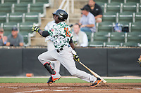 Frandy De La Rosa (25) of the Augusta GreenJackets follows through on his swing against the Kannapolis Intimidators at Kannapolis Intimidators Stadium on May 3, 2017 in Kannapolis, North Carolina.  The Intimidators defeated the GreenJackets 7-4.  (Brian Westerholt/Four Seam Images)