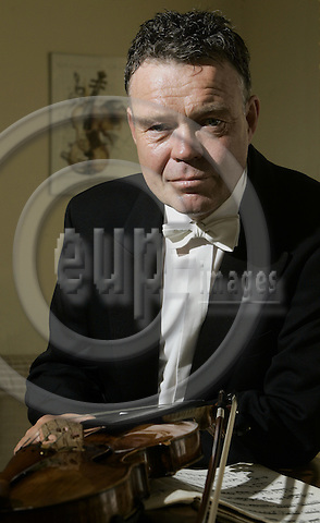 BRUSSELS - BELGIUM - 25 JUNE 2005 -- Endre KLEVE, Conductor of the Liege Philharmonica Orchestra and Professor of Violin at the Royal Conservatorium of Brussels. --  PHOTO: JUHA ROININEN / EUP-IMAGES