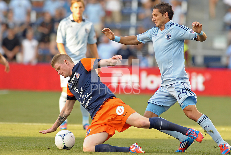 Gaetan Charbonnier (9) forward Montpellier closely marked by.Neven Markovic (25) defender Sporting KC..Sporting Kansas City were defeated 3-0 by Montpellier HSC in an international friendly at LIVESTRONG Sporting Park, Kansas City, KS..
