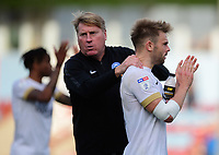 Peterborough United's assistant manager Paul Raynor, left, celebrates the win with Matthew Godden who scored both of the goals<br /> <br /> Photographer Chris Vaughan/CameraSport<br /> <br /> The EFL Sky Bet League One - Scunthorpe United v Peterborough United - Saturday 13th October 2018 - Glanford Park - Scunthorpe<br /> <br /> World Copyright &copy; 2018 CameraSport. All rights reserved. 43 Linden Ave. Countesthorpe. Leicester. England. LE8 5PG - Tel: +44 (0) 116 277 4147 - admin@camerasport.com - www.camerasport.com