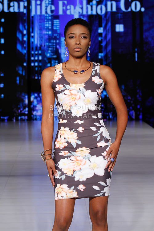 Model walks runway in an outfit from the Starlife Fashion Co. collection, during Society Fashion Week Spring Summer 2019 in New York City on September 7, 2018.