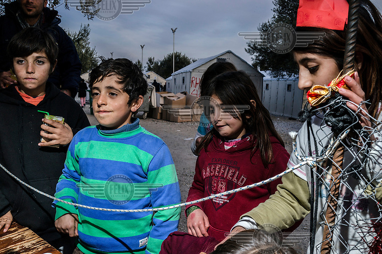 Refugee children queue up for hot food at a soup kitchen in the Kara Tepe camp.