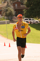 A triathlete finishes his competition at the ChelanMan Multi-Sport Weekend.