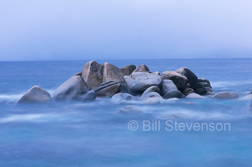 An abstract photo of rocks and blurred water along the east shore of Lake Tahoe