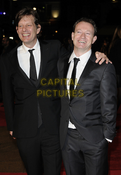 """CHRISTIAN COLSON, producer & SIMON BEAUFOY, screenwriter.The European Premiere of """"127 Hours"""" during the closing gala of the 54th BFI London Film Festival, Odeon Leicester Square, London. .28th October 2010 .LFF half length black grey gray suit arm over shoulder.CAP/CAN.©Can Nguyen/Capital Pictures."""