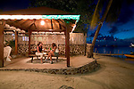 friends enjoy a couple of beers at sunset at the bar at the Frangipani Hotel, Bequia 4/05