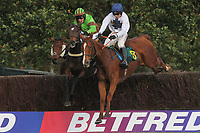Race winner Wiesentraum ridden by Leighton Aspell (R) and Victor Leudorum ridden by A P McCoy in jumping action during the October Handicap Chase