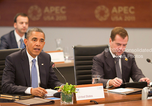 United States President Barack Obama participates in the Opening plenary session of the Asia-Pacific Economic Cooperation (APEC) summit at the J.W. Marriott Hotel in Honolulu, Hawaii on Sunday, November 13, 2011.  President Dimitry Medvedev of Russia is at right..Credit: Kent Nishimura / Pool via CNP