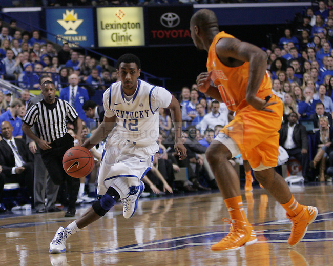 Sophomore Guard Ryan Harrow (12) crosses over Tennessee's Junior Guard Trae Golden (11) during the University of Kentucky vs Tennessee Men's Basketball game in Lexington, Ky., on, January 15, 2013. Photo by Jared Glover | Staff