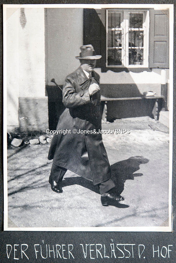 BNPS.co.uk (01202 558833)<br /> Pic: Jones&Jacob/BNPS<br /> <br /> Hitler leaving the Berghof in civilian clothes.<br /> <br /> Springtime for Hitler...Chilling album of pictures taken by one of Hitlers bodyguards illustrates the Nazi dictators rise to power.<br /> <br /> An unseen album of photographs taken by a member of Hitlers own elite SS bodyguard division in the years leading up to the start of WW2.<br /> <br /> The 1st SS Panzer Division 'Leibstandarte SS Adolf Hitler' or LSSAH began as Adolf Hitler's personal bodyguard in the 1920's responsible for guarding the Führer's 'person, offices, and residences'.