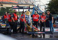 Sep 29, 2017; Madison , IL, USA; Crew members with NHRA top fuel driver Leah Pritchett during qualifying for the Midwest Nationals at Gateway Motorsports Park. Mandatory Credit: Mark J. Rebilas-USA TODAY Sports