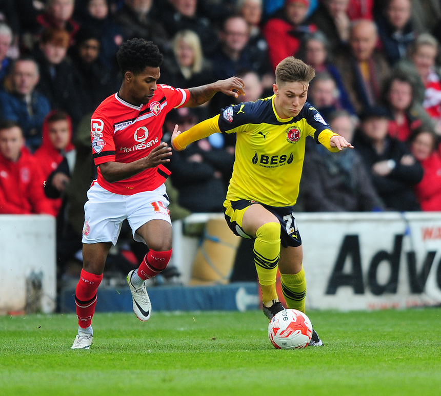 Walsall's Rico Henry vies for possession with Fleetwood Town's Nick Haughton<br /> <br /> Photographer Chris Vaughan/CameraSport<br /> <br /> Football - The Football League Sky Bet League One - Walsall v Fleetwood Town - Monday 2nd May 2016 - Banks's Stadium - Walsall   <br /> <br /> &copy; CameraSport - 43 Linden Ave. Countesthorpe. Leicester. England. LE8 5PG - Tel: +44 (0) 116 277 4147 - admin@camerasport.com - www.camerasport.com