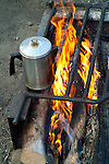 Coffee warmed over a campfire.