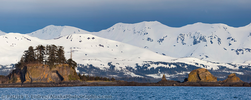 Channel Island, snow covered mountains of Montague Island in the distance, Prince William Sound, southcentral, Alaska