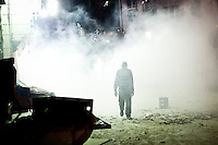 A man is walking out of the tear gas smoke throw by the police near Ramses train station in Downton Cairo, Egypt, Monday, July 15, 2013. Thousands of supporters of ousted President Mohammed Morsi held mass rallies and marched in the streets Monday to demand his return to office. The protest turned violent in downtown Cairo as police fired tear gas at pro-Morsi protesters who replied while throwing rocks and blocking the traffic. <br /> <br /> Un homme marche dans la fum&eacute;e de gaz lacrymog&egrave;ne jet&eacute; par la police pr&egrave;s de la gare Ramses dans le centre du Caire, en Egypte, le lundi 15 Juillet 2013. Des milliers de partisans du pr&eacute;sident d&eacute;chu Mohammed Morsi ont tenu des rassemblements de masse et ont d&eacute;fil&eacute; dans les rues pour exiger son retour &agrave; la pr&eacute;sidence. La manifestation a d&eacute;g&eacute;n&eacute;r&eacute;  alors que la police a tir&eacute; des gaz lacrymog&egrave;nes sur les manifestants pro-Morsi qui ont r&eacute;pondu en lan&ccedil;ant des pierres et en bloquant le traffic.