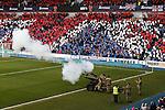 An artillery gun signals the start of a minutes silence at Ibrox before kick off