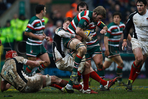 05.03.2011 Tom Croft is tackled by Owen Farrell.  Rugby Union Aviva Premiership from Welford Road.  Final score: leicester Tigers 14-15 Saracens.