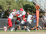 Palos Verdes, CA 10/24/14 - Michael Navarro (Redondo Union #40) and Andrew Phillips (Peninsula #16)in action during the Redondo Union - Palos Verdes Peninsula CIF Varsity football game at Peninsula High School.