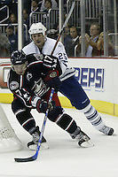 20 October 2006: Columbus Blue Jackets' Gilbert Brule, left, plays against Toronto Maple Leafs' Hal Gill at Nationwide Arena in Columbus, Ohio.<br />
