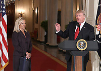 United States President Donald J. Trump, right. announces he will name Principal Deputy White House Chief of Staff Kirstjen Nielsen, left, as Secretary of Homeland Security in the East Room of the White House in Washington, DC on Thursday, October 12, 2017.  If confirmed, Nielsen will replace Acting US Secretary of Homeland Security Elaine C. Duke, who has been in that position since General John F. Kelly, USMC (Retired) resigned to become White House Chief of Staff.<br /> Credit: Ron Sachs / CNP /MediaPunch