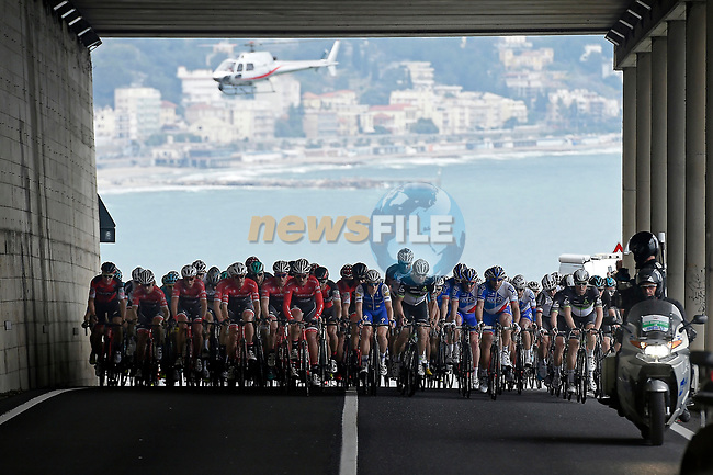 The peloton ride along the Ligurian coast during the 108th edition of Milan-San Remo 2017 by NamedSport the first Classic Monument of the season running 291km from Milan to San Remo, Italy. 18th March 2017.<br /> Picture: La Presse/Fabio Ferrari | Cyclefile<br /> <br /> <br /> All photos usage must carry mandatory copyright credit (&copy; Cyclefile | La Presse)