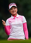 Yuting Shi of China poses for photos during the Hyundai China Ladies Open 2014 Pro-am on December 10 2014 at Mission Hills Shenzhen, in Shenzhen, China. Photo by Xaume Olleros / Power Sport Images