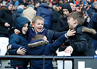29th February 2020; London Stadium, London, England; English Premier League Football, West Ham United versus Southampton; Young West Ham United supporters celebrating inside the London Stadium after the final whistle and a 3-1 win