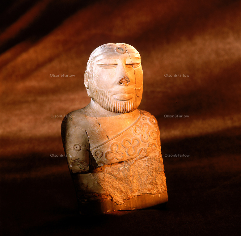 Priest King--Icon of Indus civilization--dating to around 2200-1900 BC   4,800 years ago, at the same time as the early civilizations of Mesopotamia and Egypt, great cities arose along the flood plains of the Indus and Saraswati (Ghaggar-Hakra) rivers.  Developments at Harappa have pushed the dates back 200 years for this civilization, proving once and for all, that this civilization was not just an offshoot of Mesopotamia..They were a highly organized and very successful civilization.  They built some of the world's first planned cities, created one of the world's first written languages and thrived in an area twice as large as Egypt or Mesopotamia for 900 years (1500 settlements spread over 280,000 square miles on the subcontinent)..There are three major communities--Harappa, Mohenjo Daro, and Dholavira. The town of Harappa flourished during this period because of it's location at the convergence of several trade routes that spanned a 1040 KM swath from the northern mountains to the coast.