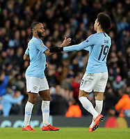 Manchester City's Raheem Sterling (left) celebrates with team-mate Leroy Sane after scoring his side's fourth goal <br /> <br /> Photographer Rich Linley/CameraSport<br /> <br /> UEFA Champions League Round of 16 Second Leg - Manchester City v FC Schalke 04 - Tuesday 12th March 2019 - The Etihad - Manchester<br />  <br /> World Copyright © 2018 CameraSport. All rights reserved. 43 Linden Ave. Countesthorpe. Leicester. England. LE8 5PG - Tel: +44 (0) 116 277 4147 - admin@camerasport.com - www.camerasport.com