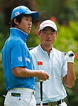 SHENZHEN, CHINA - OCTOBER 30: Mu Hu of China (R) talks with Chang-Won Han of South Korea during the day two of Asian Amateur Championship at the Mission Hills Golf Club on October 30, 2009 in Shenzhen, Guangdong, China.  (Photo by Victor Fraile/The Power of Sport Images) *** Local Caption *** Mu Hu; Chang-Won Han
