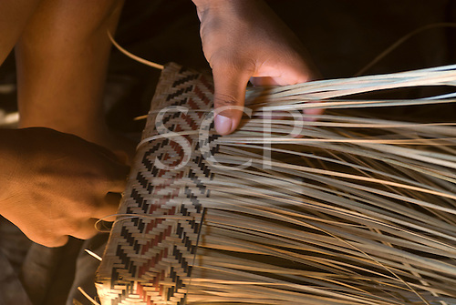 Xingu Indigenous Park, Mato Grosso State, Brazil. Aldeia Waura. Making a basket.