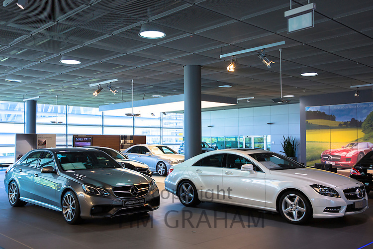 Mercedes-AMG E63 AMG Saloon V8 biturbo (left) and Mercedes C350 AMG Sport (right) in Mercedes-AMG showroom in Stuttgart, Germany