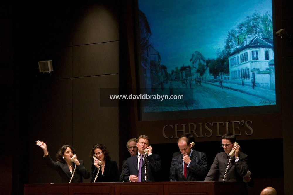 8 November 2006 - New York City, USA - Christie's employees take bids over the phone during an Impressionist and Modern Art Sale in New York City, NY, which realized $491,472,000 and nine new world auction records, 8 November 2006.