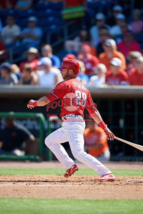 Philadelphia Phillies second baseman Andrew Romine (28) follows through on a swing during a Grapefruit League Spring Training game against the Baltimore Orioles on February 28, 2019 at Spectrum Field in Clearwater, Florida.  Orioles tied the Phillies 5-5.  (Mike Janes/Four Seam Images)