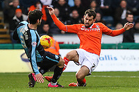 Joe Jacobson of Wycombe Wanderers and Alex Lawless of Luton Town during the Sky Bet League 2 match between Wycombe Wanderers and Luton Town at Adams Park, High Wycombe, England on 6 February 2016. Photo by David Horn.