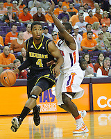 Nov 30, 2010; Clemson, SC, USA;  Michigan Wolverines guard Darius Morris (4) drives around a Clemson player in the game against the Clemson Tigers at Littlejohn Coliseum. Mandatory Credit: Daniel Shirey/WM Photo -US PRESSWIRE