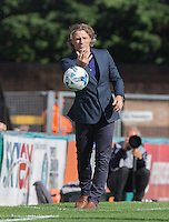 Wycombe Wanderers Manager Gareth Ainsworth throws the ball during the Sky Bet League 2 match between Wycombe Wanderers and Plymouth Argyle at Adams Park, High Wycombe, England on 12 September 2015. Photo by Andy Rowland.