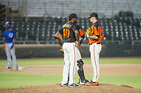 AZL Giants pitching coach Mario Rodriguez (40) meets with catcher Andres Angulo (1) and relief pitcher Jake Greenwalt (67) on the mound during Game Three of the Arizona League Championship Series against the AZL Cubs on September 7, 2017 at Scottsdale Stadium in Scottsdale, Arizona. AZL Cubs defeated the AZL Giants 13-3 to win the series two games to one. (Zachary Lucy/Four Seam Images)