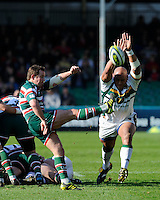 James Grindal of Leicester Tigers sends up a box kick as Soane Tonga'uiha of Northampton Saints attempts to bliock during the LV= Cup Final match between Leicester Tigers and Northampton Saints at Sixways Stadium, Worcester on Sunday 18 March 2012 (Photo by Rob Munro, Fotosports International)