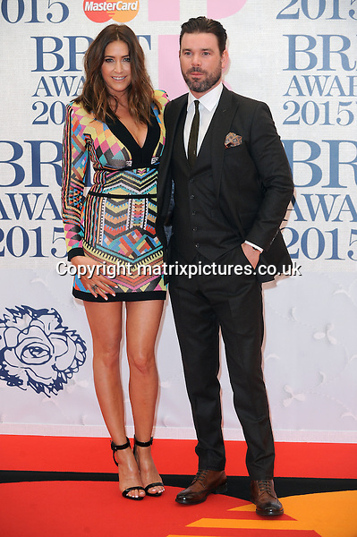 NON EXCLUSIVE PICTURE: PAUL TREADWAY / MATRIXPICTURES.CO.UK<br /> PLEASE CREDIT ALL USES<br /> <br /> WORLD RIGHTS<br /> <br /> English presenters Dave Berry and Lisa Snowdon attending the BRIT Awards 2015 at the O2 Arena, in London.<br /> <br /> FEBRUARY 25th 2015<br /> <br /> REF: PTY 15627