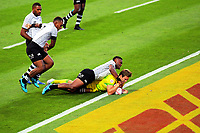 Australia's Lachie Anderson scores duirng the pool match against Fiji on day one of the 2018 HSBC World Sevens Series Hamilton at FMG Stadium in Hamilton, New Zealand on Saturday, 3 February 2018. Photo: Dave Lintott / lintottphoto.co.nz