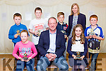 Irish and Munster legend Mick Galwey presented the Con Houlihan short story awards in the Castlisland Rugby club on saturday night front row l-r: Abigail Martin Castleisland Presentation NS, Mick Galwey, Holly geary Novil NS. Back row: Sean Keane Loughfouder NS, Alex Regan Gaelscoil aogain, Peter Burke Castleisland Boys NS and Kalum Buckley Scartaglen NS