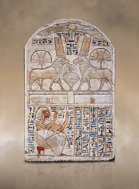 """Ancient Egyptian stele odedicated to Amon Re the """"good Ram"""" by foreman Baki, limestone, New Kingdom, 19th Dynasty, (1290-1213 BC), Deir el-Medina, Drovetti cat 1549. Egyptian Museum, Turin. Reign of Ramesses II.<br /> <br /> This round-topped stele is carved in low relief and painted <br /> in several colours. The pictorial plane is divided into two <br /> registers, the upper one containing two rams facing each <br /> other. The animals, with cobras rising on their foreheads, <br /> wear tall headdresses composed of two tall plumes with a <br /> solar disk at the centre. Between them is a small offering <br /> table with lotus flowers. The mirror image hieroglyphic <br /> inscription refers to the rams and reveals their divine <br /> nature as that of Amun-Ra. In the register below, <br /> foreman Baki is shown in the pose of adoration."""