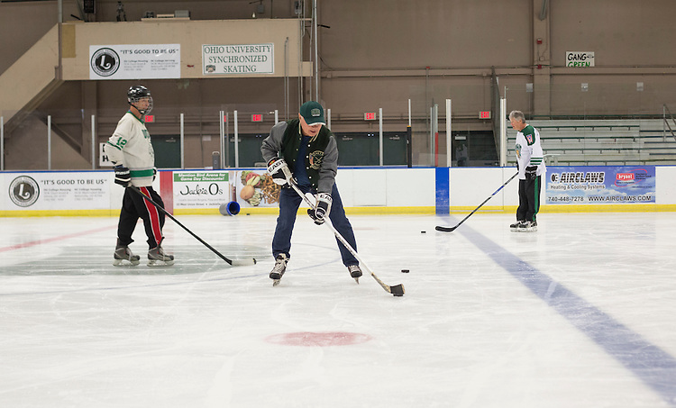 Dave Shawn, left, Tom Gosiorowski, center, and Dennis Corbett, right skate at Bird Arena with other 1960s hockey alumni on October 1, 2016.