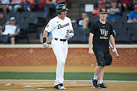 Chris Lanzilli (24) of the Wake Forest Demon Deacons after hitting a home run against the North Carolina State Wolfpack at David F. Couch Ballpark on April 18, 2019 in  Winston-Salem, North Carolina. The Demon Deacons defeated the Wolfpack 7-3. (Brian Westerholt/Four Seam Images)