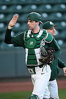 Catcher Scott Combs (35) of the Michigan State Spartans is congratulated after throwing out a runner at second in a game against the Merrimack Warriors on Saturday, February 22, 2020, at Fluor Field at the West End in Greenville, South Carolina. Merrimack won, 7-5. (Tom Priddy/Four Seam Images)