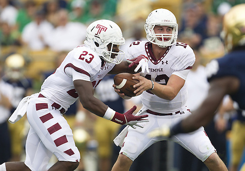 August 31, 2013:  Temple quarterback Connor Reilly (12) hands the ball off to running back Zaire Williams (23) during NCAA Football game action between the Notre Dame Fighting Irish and the Temple Owls at Notre Dame Stadium in South Bend, Indiana.  Notre Dame defeated Temple 28-6.