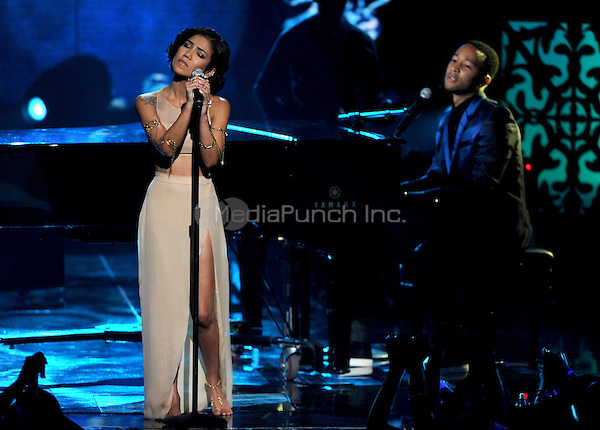 LOS ANGELES, CA - JUNE 29 : (L-R) Jhene Aiko and John Legend perform onstage at the BET Awards '14 at Nokia Theatre L.A. Live on June 29, 2014 in Los Angeles, California. Credit: PGMicelotta/MediaPunch