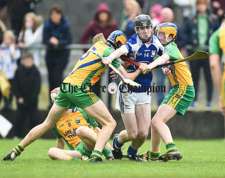 Oisin Cahill of Kilmaley in action against Keith White and Padraig Devitt of Inagh-Kilnamona during the U-16A final in Clarecastle. Photograph by John Kelly.